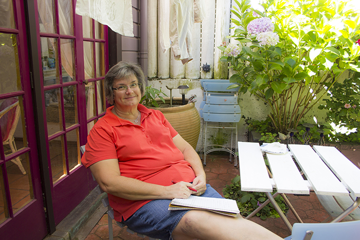 Carole Warren in backyard of the Cottage on Collingwood