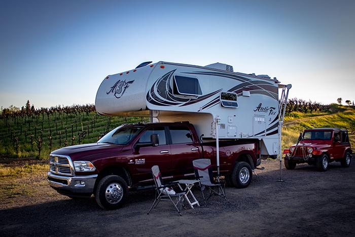 photo of camper near vineyard