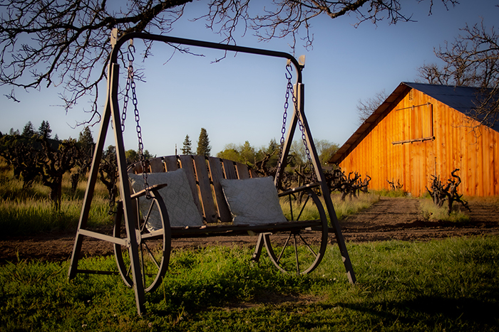porch swing made of iron wagon wheels